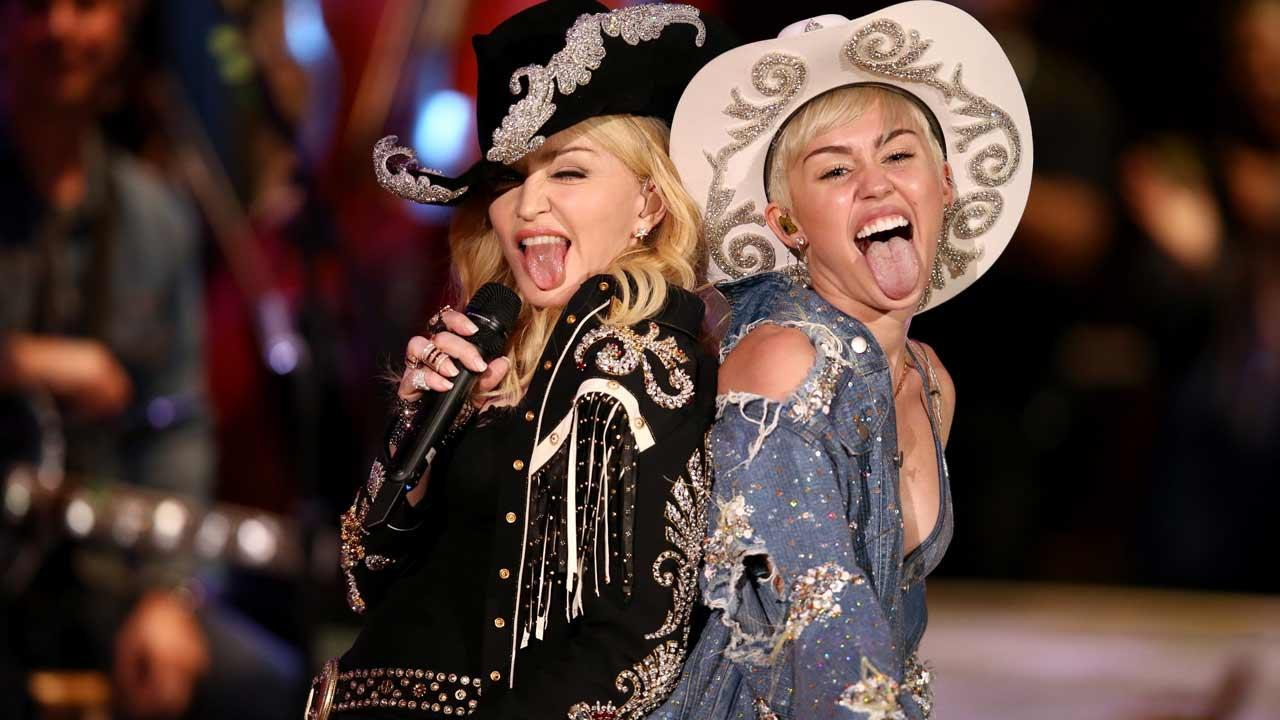 Miley Cyrus and Madonna appear on Cyrus MTV Unplugged special on Jan. 29, 2014.