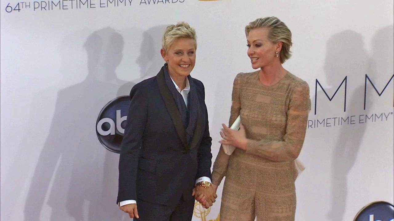 Ellen DeGeneres and wife Portia de Rossi walk the red carpet at the 2013 Emmy Awards in Los Angeles on Sept. 22, 2013.