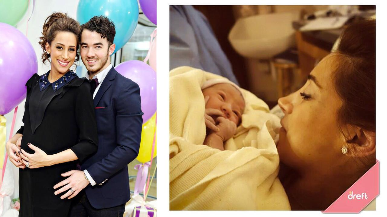 Kevin Jonas and Danielle Jonas welcomed their first child, Alena Rose Jonas, onSunday, Feb. 2, 2014. Pictured: The couple appears at a baby shower on Dec. 4, 2013. / Kevin retweeted this photo posted by Dreft that shows his wife and baby on Feb. 2, 2014.)