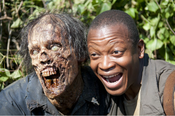 "<div class=""meta ""><span class=""caption-text "">An actor dressed as a Walker and Lawrence Gilliard Jr. (Bob Stookey) pose for a photo on the set of AMC's 'The Walking Dead' while filming episode 4 of season 4, titled 'Indifference,' which aired on Nov. 3, 2013. (Gene Page / AMC)</span></div>"