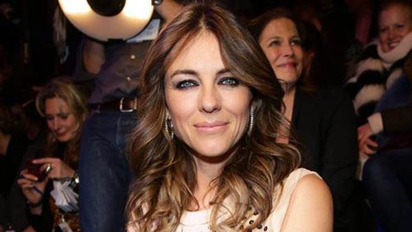 Elizabeth Hurley denies Bill Clinton affair rumors. Pictured: Hurley appears during Berlin Fashion Week on Jan. 16, 2014. - Provided courtesy of James Coldrey/startraksphoto.com