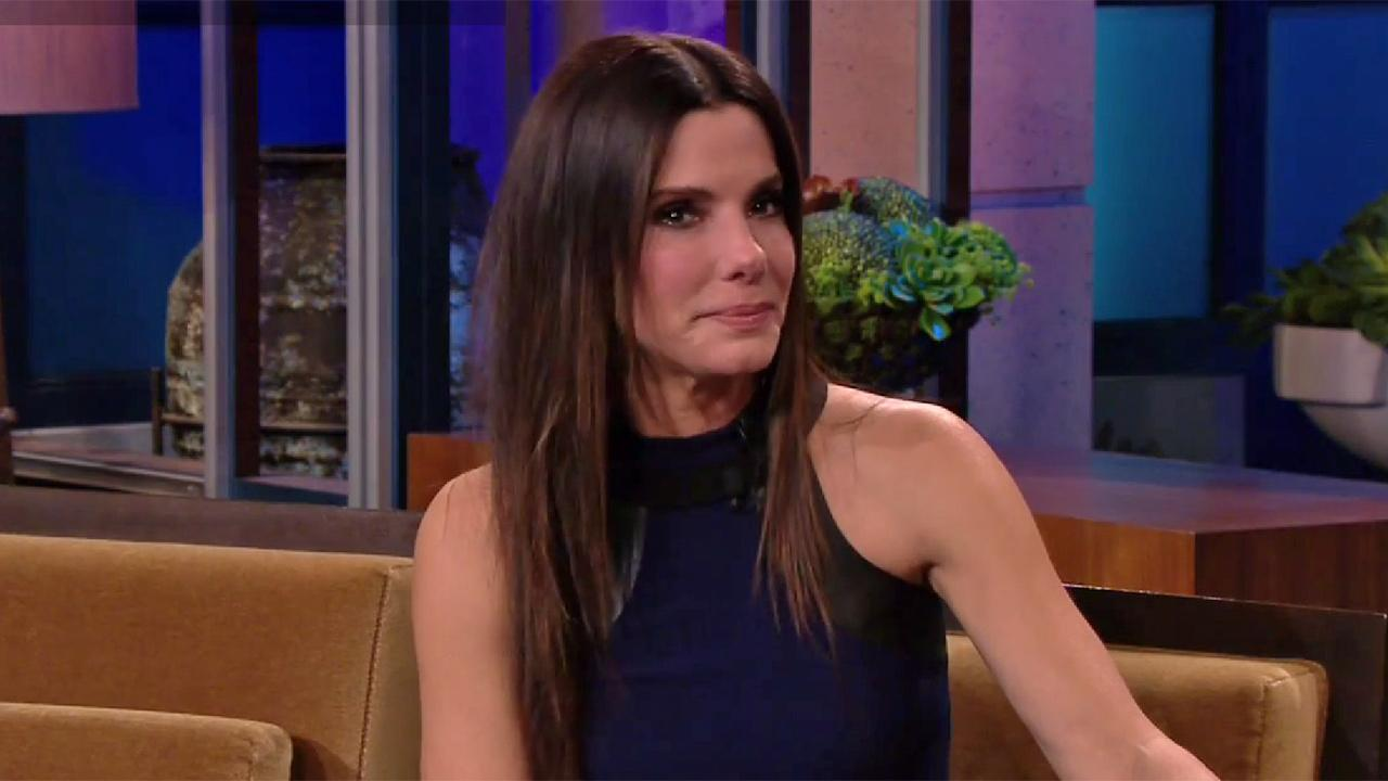 Sandra Bullock gets emotional while talking to Jay Leno on his second-to-last Tonight Show appearance as host on Feb. 5, 2014.