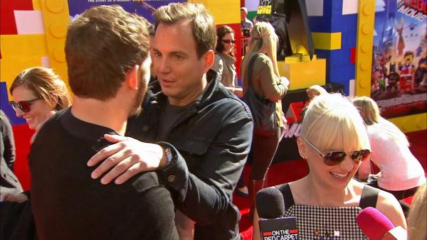 Will Arnett hugs Chris Pratt and kisses Anna Faris during an interview with OTRC.com at the premiere of The Lego Moviein Los Angeles on Feb. 1, 2014.