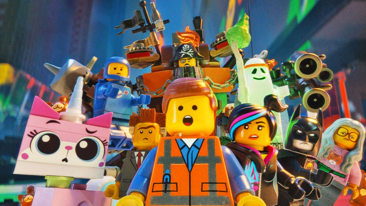 LEGO characters Unikitty (voiced by ALISON BRIE), Benny (CHARLIE DAY), Metal Beard (NICK OFFERMAN), Vitruvius (MORGAN FREEMAN), Batman (WILL ARNETT), Wyldstyle (ELIZABETH BANKS), Emmet (CHRIS PRATT)  in The LEGO Movie.
