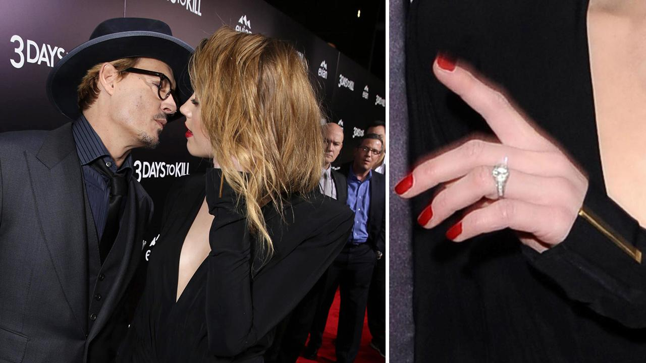Johnny Depp and reported fiancee Amber Heard, who wore a diamond ring, kiss at the premiere of the movie 3 Days To Kill in Los Angeles on Feb. 12, 2014. It was reported in January that the two are engaged, although the pair has not confirmed this.