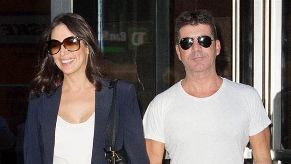 Simon Cowell, former American Idol and The X Factor USA judge, appears with pregnant girlfriend Lauren Silverman in New York on Sept. 19, 2013. The two welcomed a baby boy -- his first child -- on Feb. 14, 2014 -- Valentines Day. - Provided courtesy of Freddie Baez / Startraksphoto.com
