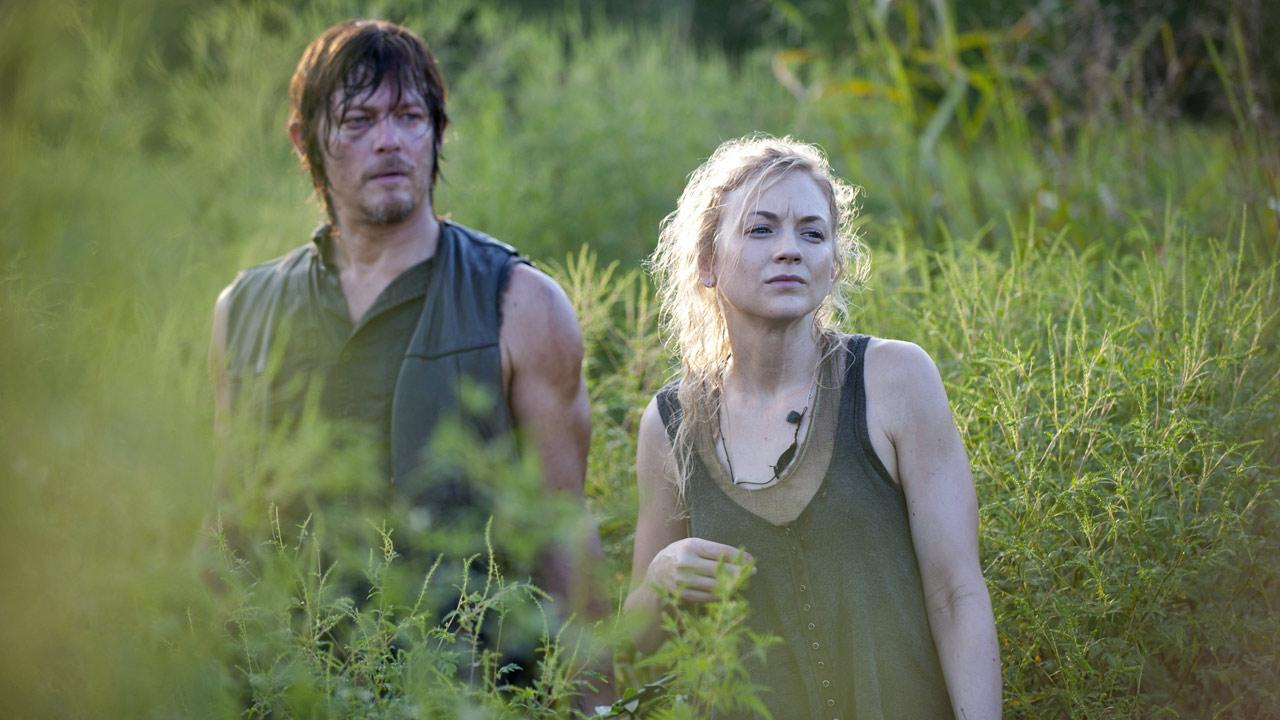 Norman Reedus appears as Daryl Dixon and Emily Kinney appears as Beth Greene in a scene AMCs The Walking Dead, season 4, episode 10 -- Inmates.