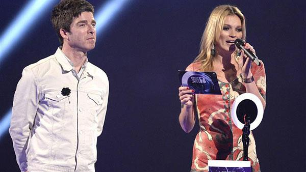 Kate Moss accepts David Bowies award for British Male Artist of the Year at the 2014 BRIT Awards in London on Feb. 19, 2014. Also pictured: Noel Gallagher. - Provided courtesy of NBC