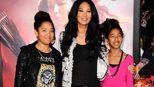 Kimora Lee Simmons appears with daughters Ming Lee and Aoki Lee at the Los Angeles, California premiere of The Hunger Games: Catching Fire on Nov. 18, 2013. - Provided courtesy of Sara De Boer / startraksphoto.com