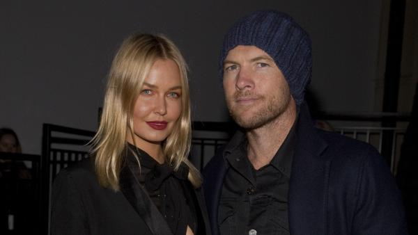 Lara Bingle, left, and boyfriend and actor Sam Worthington, right, attend the MBFW 2014 Fall/Winter Alexander Wang fashion show on Feb. 8, 2014. The Avatar actor was arrested on Feb. 23 after punching a photographer who kicked Bingle, police say. - Provided courtesy of Andy Kropa / Invision / AP
