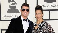 Robine Thicke and wife Paula Patton appear at the 2014 Grammy Awards in Los Angeles on Jan. 26, 2014. It was reported on Feb. 24, 2014 that the couple had separated and plans to end their eight-year marriage. They have one child together. - Provided courtesy of Kyle Rover / Startraksphoto.com