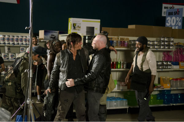"<div class=""meta image-caption""><div class=""origin-logo origin-image ""><span></span></div><span class=""caption-text"">Norman Reedus (Daryl Dixon) appears on the set of AMC's 'The Walking Dead' while filming episode 1 of season 4, titled '30 Days Without an Accident,' which aired on Oct. 20, 2013. Pictured with him is visiting actor Michael Rooker, whose character Merle Dixon, Daryl's brother, was killed in the previous season. (Gene Page / AMC)</span></div>"