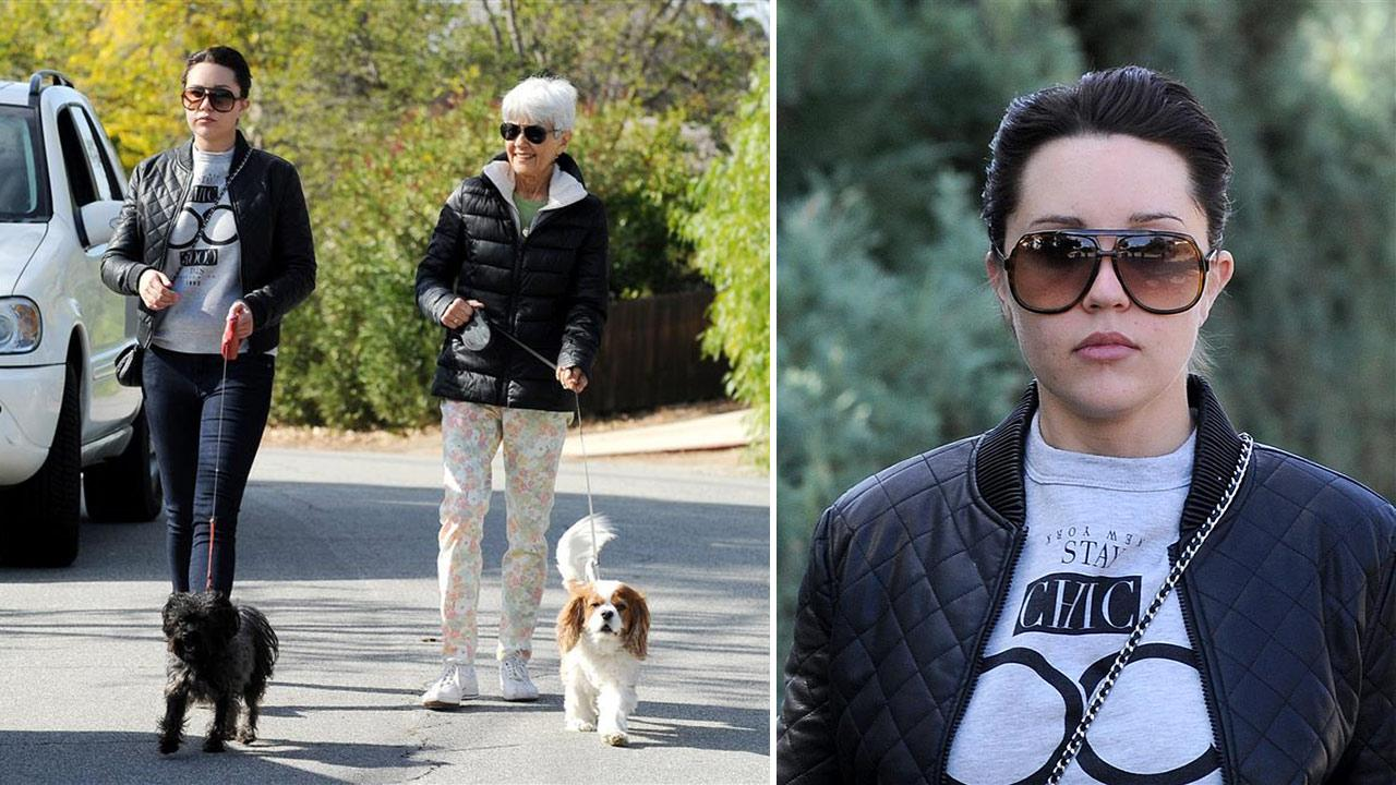 Amanda Bynes walks her dogs with her mother in Thousand Oaks, California on Dec. 8, 2013. The actress, who had faced several legal issues and spent time in rehab in late 2013, struck a plea deal over a 2012 DUI case and was given three years of probation.