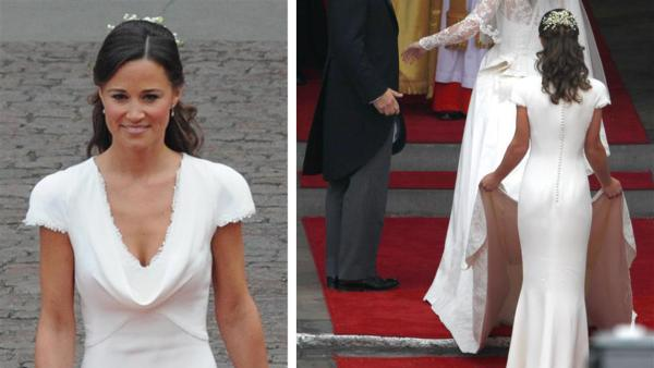 Pippa Middleton holds her sister Kate Middletons train at her Royal Wedding to Prince William at Westminster Abbey in London on April 29, 2011. - Provided courtesy of AMH / Startraksphoto.com