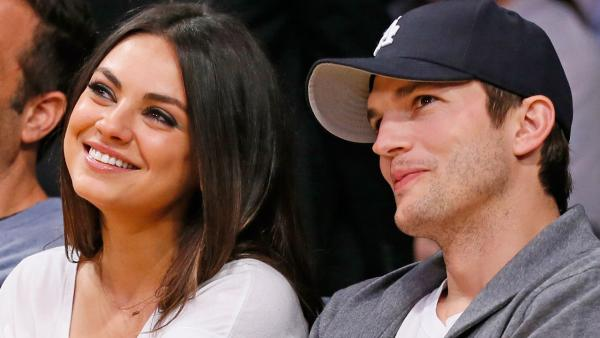 Actress Mila Kunis, left, and actor Ashton Kutcher, right, sit courtside together at the NBA basketball game between the Phoenix Suns and Los Angeles Lakers on Tuesday, February 12, 2013, in Los Angeles. - Provided courtesy of AP Photo / Danny Moloshok