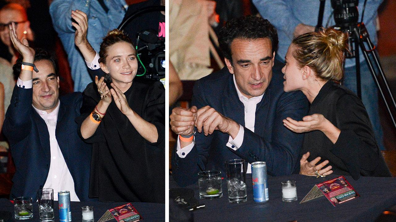 Mary-Kate Olsen and boyfriend Olivier Sarkozy watch Ronnie Wood of the Rolling Stones perform with guitarist Mick Taylor, drummer Simon Kirke and keyboardist Al Cooper at The Cutting Room in New York on Thursday, Nov. 7, 2013.