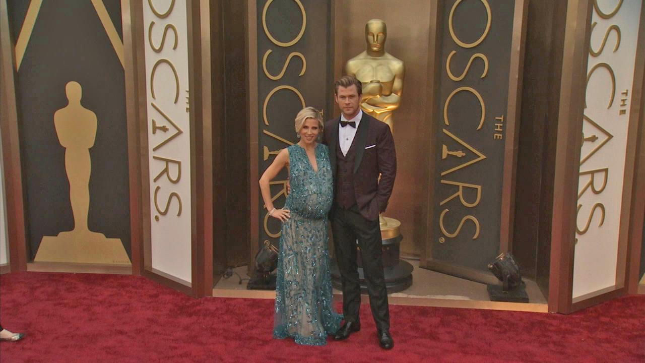 Chris Hemsworth and wife Elsa Pataky walk the red carpet at the 2014 Oscars in Hollywood, California on Sunday, March 2, 2014.