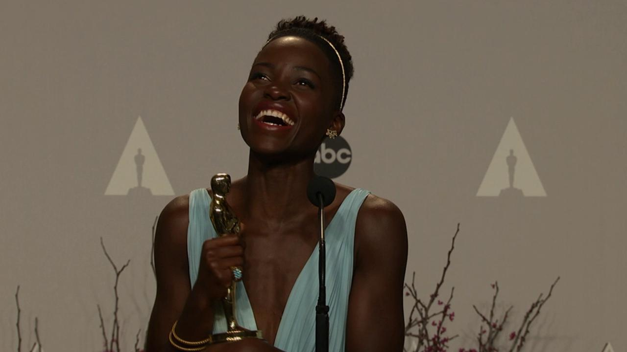 Lupita Nyongo talks backstage after winning Best Supporting Actress at the 2014 Oscars on March 2, 2014.