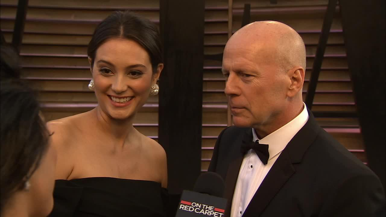 Bruce Willis and pregnant wife Emma Heming talk to OTRC.com at the Vanity Fair Oscars after party on March 2, 2014.