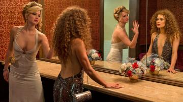 Jennifer Lawrence and Amy Adams appear in a scene from the 2013 movie American Hustle. - Provided courtesy of Columbia Pictures