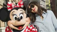 Katie Holmes poses with Minnie Mouse at the Walt Disney World Resort in Lake Buena Vista, Flo