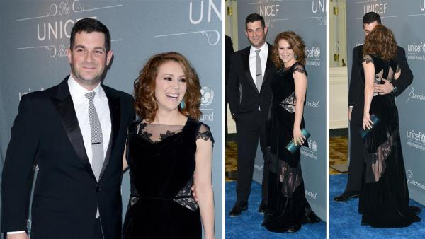 Alyssa Milano and husband David Bulgiari appear at the 2014 UNICEF Ball at the Beverly Wilshire Hotel in Beverly Hills, California on Jan. 14, 2014. She announced on March 21, 2014 that the two are expecting their second child.