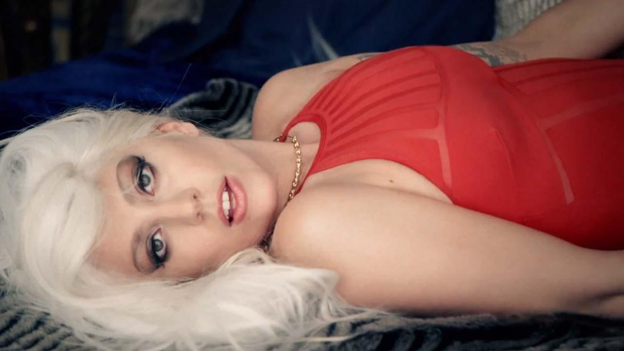Lady Gaga appears in a still from the 2014 music video for the song G.U.Y.