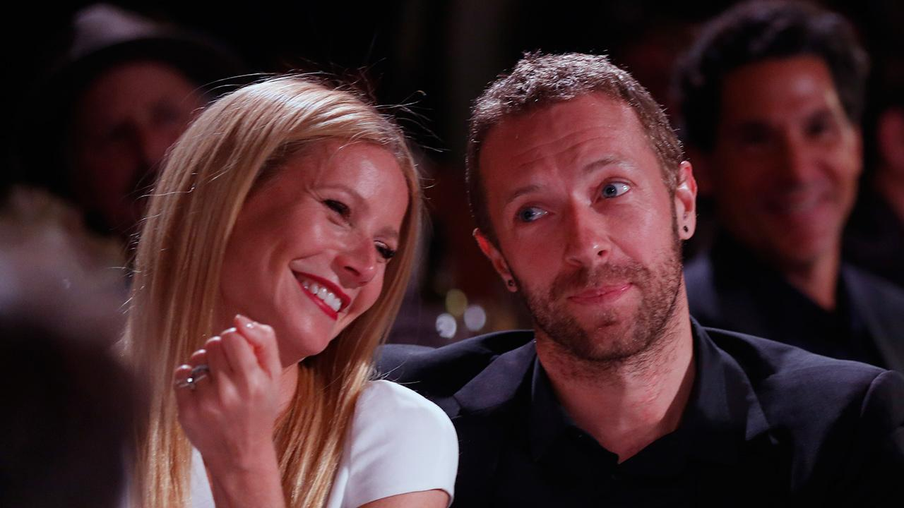 Gwyneth Paltrow, left, and Chris Martin attend the Sean Penn and Friends Help Haiti Home Gala at the Montage hotel in Beverly Hills, California on Jan. 11, 2014 . Paltrow and Martin announced via a Goop post on March 25, 2014 that they plan to separate.