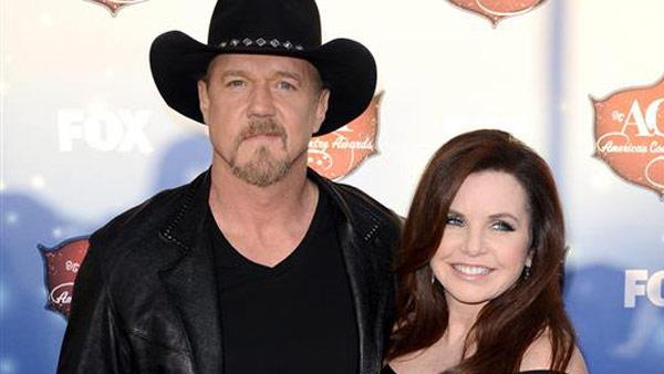 Trace Adkins and Rhonda Adkins appear at the 2013 American Country Awards on Dec. 10, 2013.