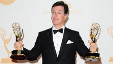 Stephen Colbert, host of The Colbert Report, appears with his two Emmys at the 2013 Emmy Awards on Sept. 22, 2013. Colbert drew controversy on March 27, 2018 over a Twitter comment many deemed racist, which was also made on the show. - Provided courtesy of Kyle Rover / Startraksphoto.com