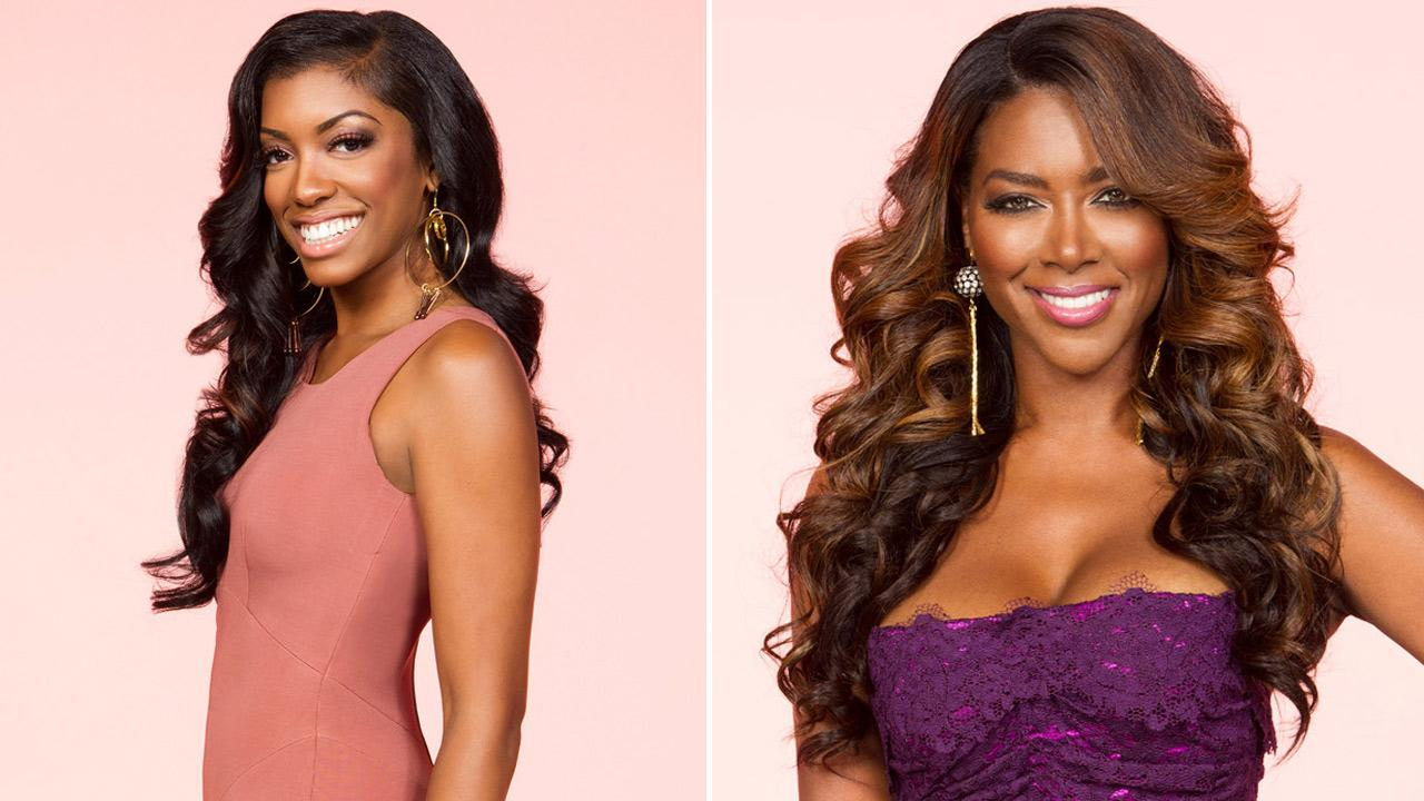 Porsha Stewart and Kenya Moore appear in 2012 promotional photos for season 5 of The Real Housewives of Atlanta.