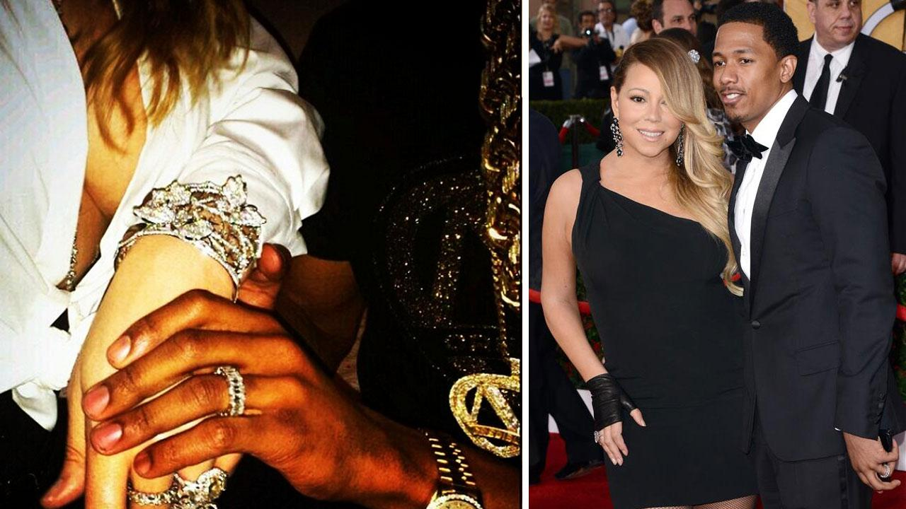 Mariah Carey and Nick Cannon appear at the 2014 SAG Awards in Los Angeles on Jan. 18, 2014. / Cannon posted an Instagram photo of a 44th birthday gift for Carey on March 27, 2014.