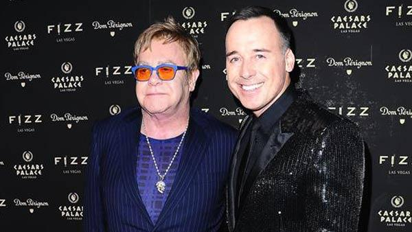 Elton John and David Furnish appear at Fizz Las Vegas to celebrate the singers 67th birthday on March 28, 2014. - Provided courtesy of Dave Proctor / startraksphoto.com