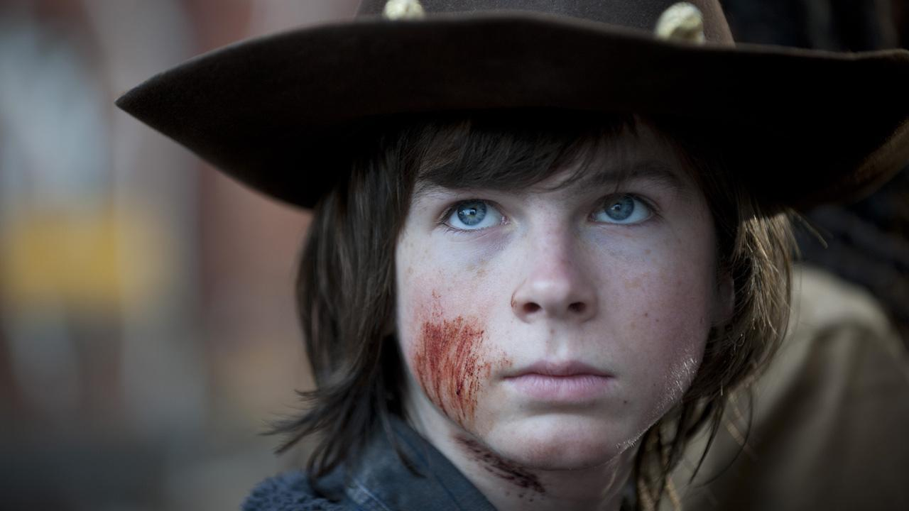 Chandler Riggs (Carl Grimes) appears in a scene from AMCs The Walking Dead, season 4 finale, episode 16 -- A -- that aired on March 30, 2014.