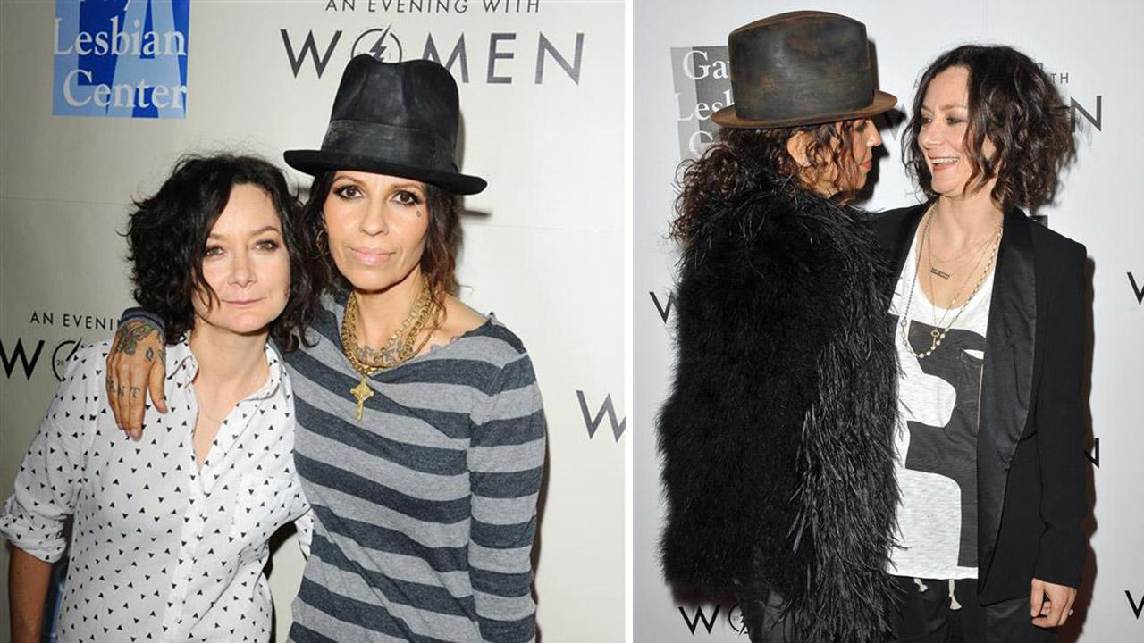 Sara Gilbert and Linda Perry, former singer of 4 Non Blondes, attend the L.A. Gay and Lesbian Center Kick-Off Concert at The Roxy in Los Angeles on March 15, 2014. / The two appear at the centers event on May 18, 2013. Gilbert and Perry wed on March 30.Daniel Robertson / Giulio Marcocchi / Startraksphoto.com