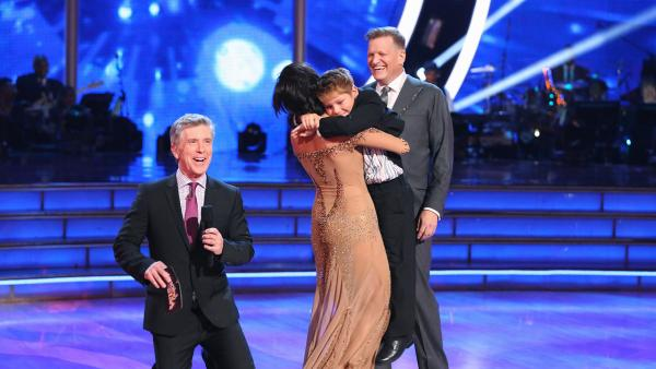 Drew Carey watches as partner Cheryl Burke hugs his son, Connor, after it is announced the two are safe from elimination on week 3 of ABCs Dancing With The Stars on March 31, 2014. - Provided courtesy of ABC Photo / Adam Taylor