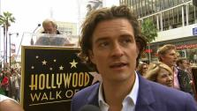 Orlando Bloom talks to OTRC.com about his and Miranda Kerrs son Flynn after receiving a star on the Hollywood Walk of Fame on April 2, 2014.