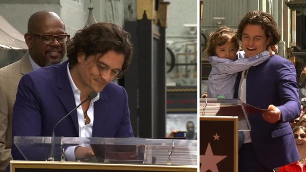 Orlando Bloom, with son Flynn, thanks Miranda Kerr during his speech at the unveiling of his star on the Hollywood Walk of Fame on April 2, 2014.