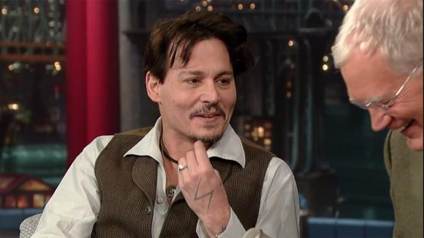 Johnny Depp appears on The Late Show with David Letterman on April 3, 2014. He talked about his engagement to Amber Heard and explained why he is wearing a chicks ring. - Provided courtesy of CBS