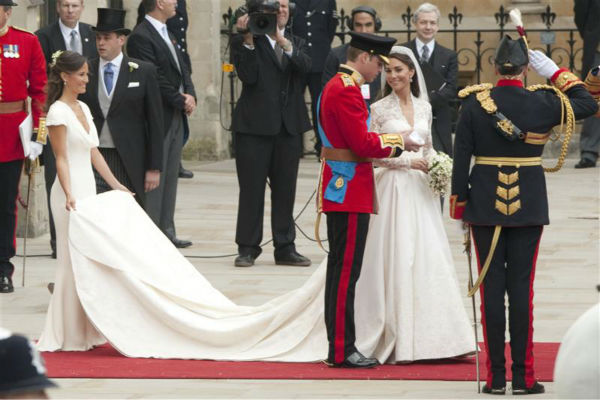 "<div class=""meta ""><span class=""caption-text "">Pippa Middleton holds her sister Kate Middleton's train at her Royal Wedding to Prince William at Westminster Abbey in London on April 29, 2011. Pippa became famous due to her a cowl-neck, body-hugging, ivory bridesmaid gown by Sarah Burton at Alexander McQueen. (Guido Ohlenboste / Startraksphoto.com)</span></div>"
