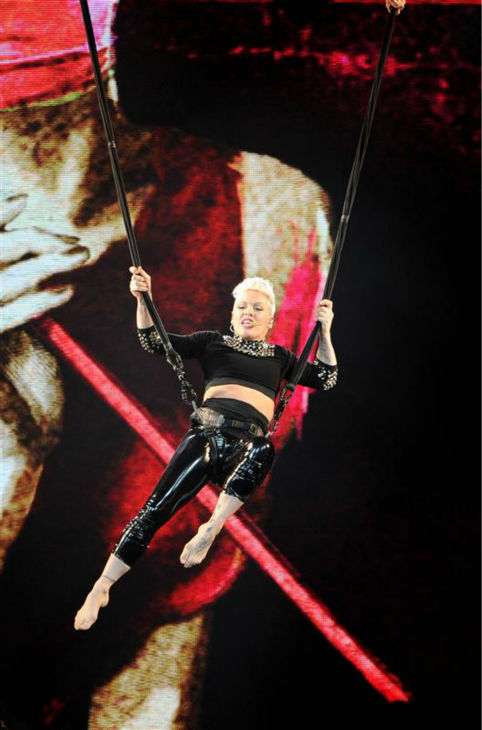 Pink performs an acrobatic stunt during her concert at the Honda Center in Anaheim, California on Jan. 29, 2014 as part of her Truth About Love tour. <span class=meta>(Rockin Exposures &#47; Startraksphoto.com)</span>