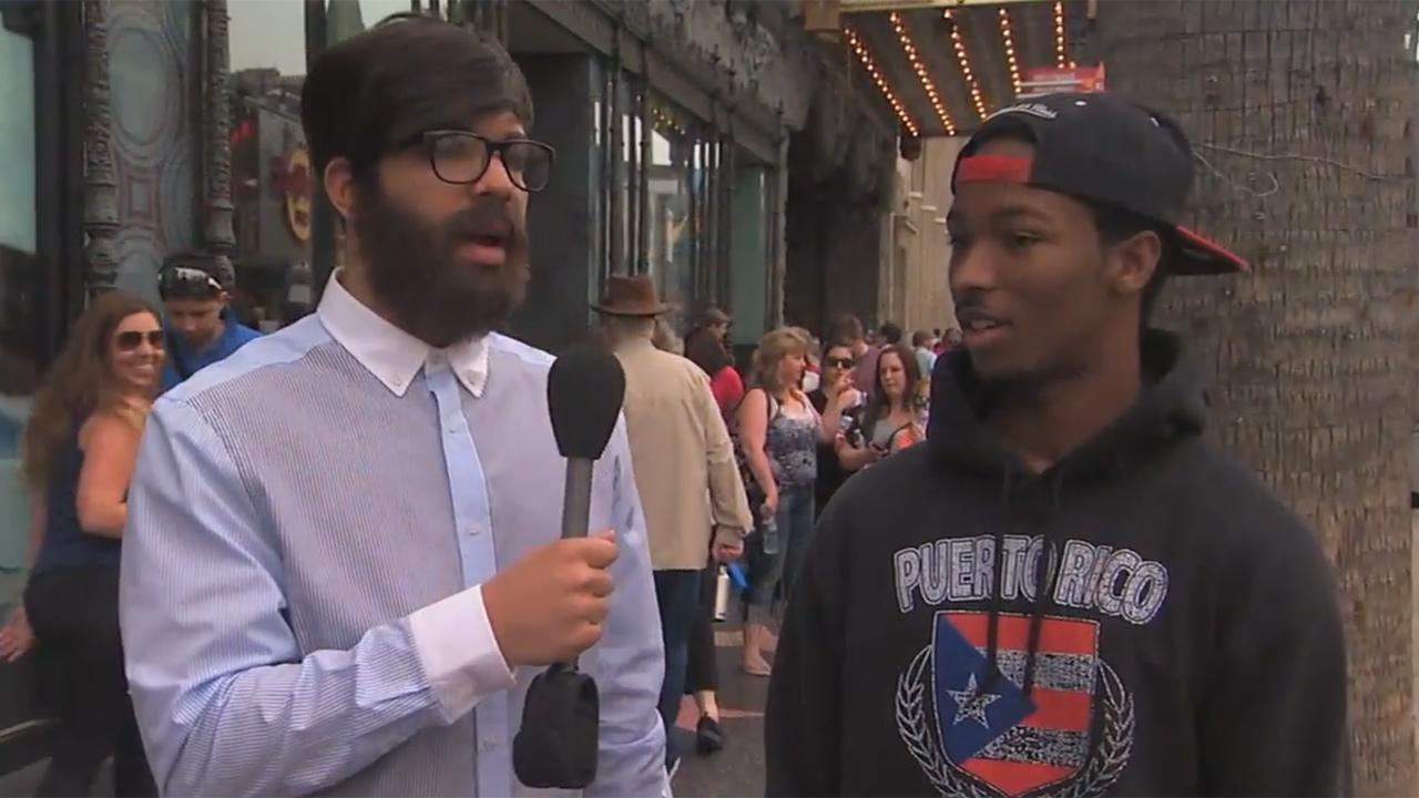 Rapper Drake, in disguise, talks to a man on a street in Hollywood, California as part of an I Witness News segment taped for ABCs Jimmy Kimmel Live! that aired on April 10, 2014.ABC