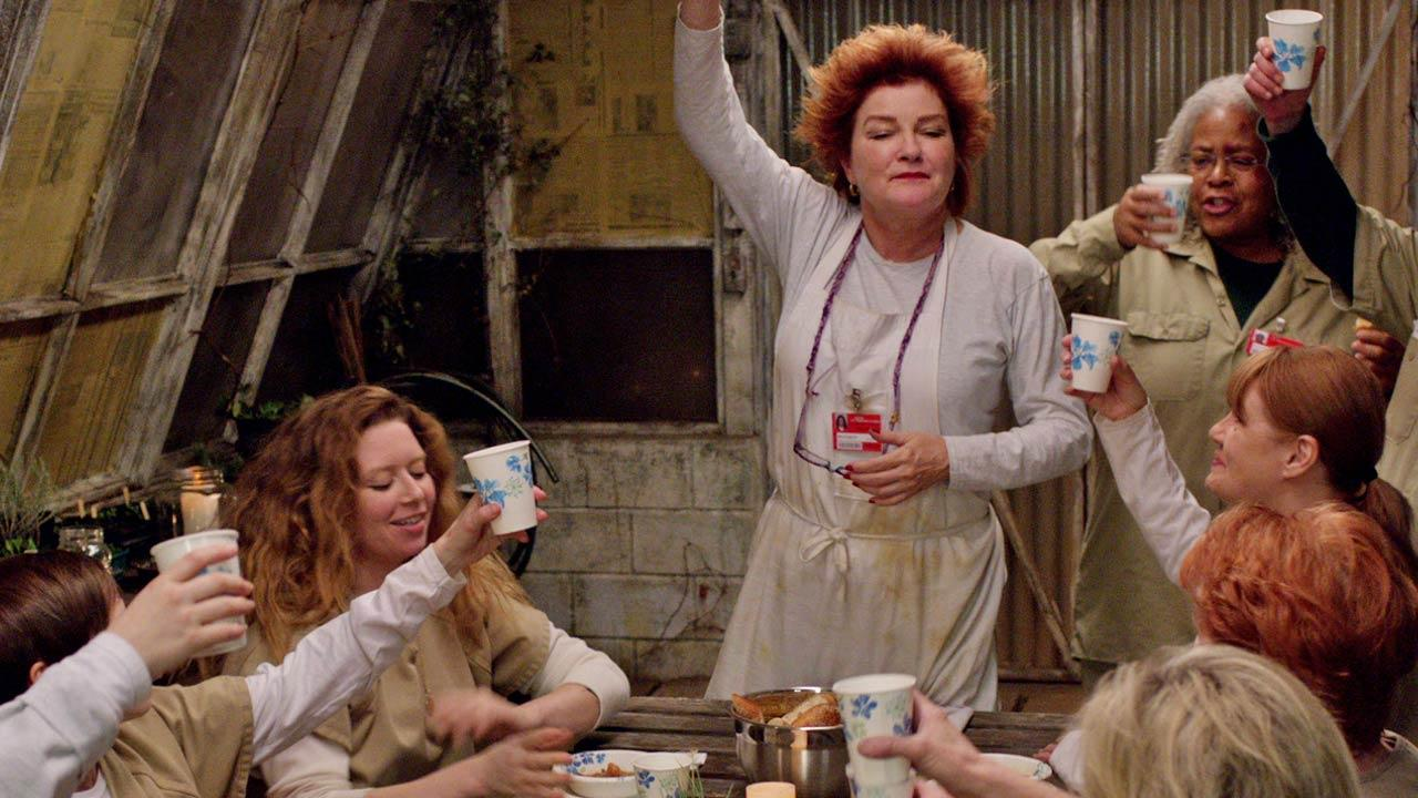 The cast of Orange Is The New Black appear in a scene from season 2 of the show in 2014.
