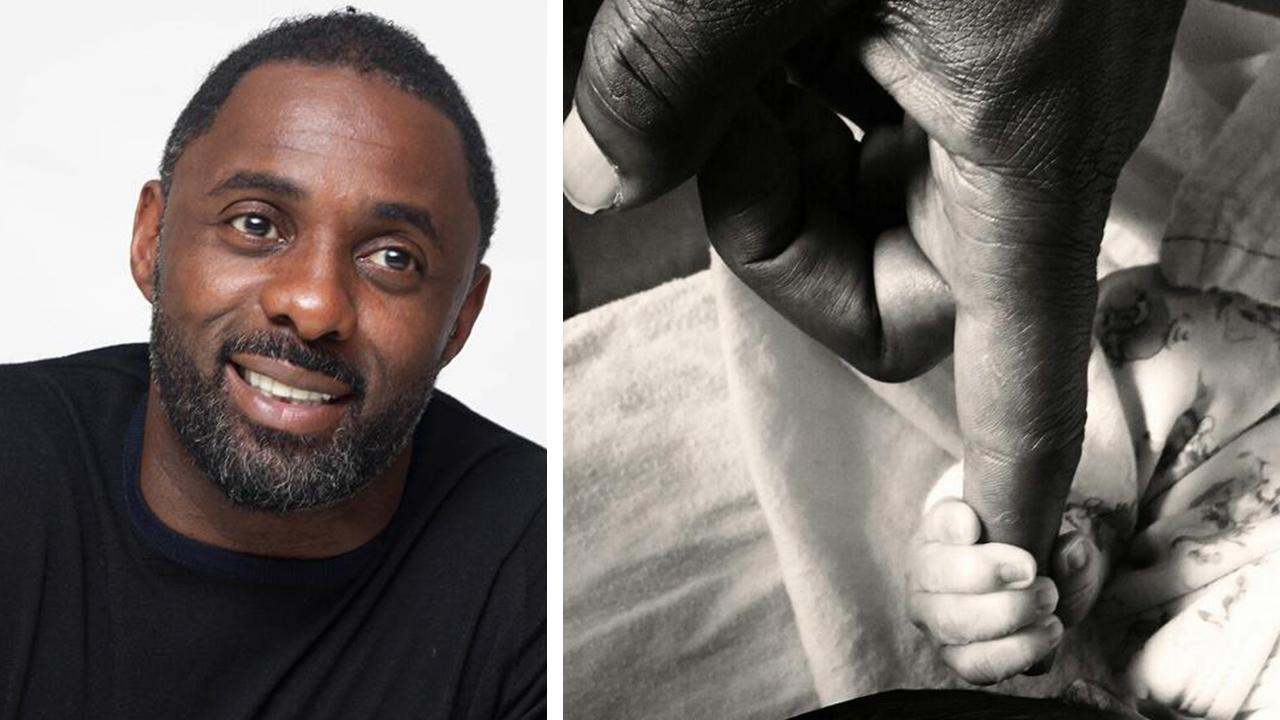 Idris Elba appears at a press conference for Mandela: Long Walk To Freedom in California on Nov. 11, 2013. / Idris Elba posted this photo of his newborn son, Winston, touching his finger, on his Twitter page on April 18, 2014. He was born a day earlier.