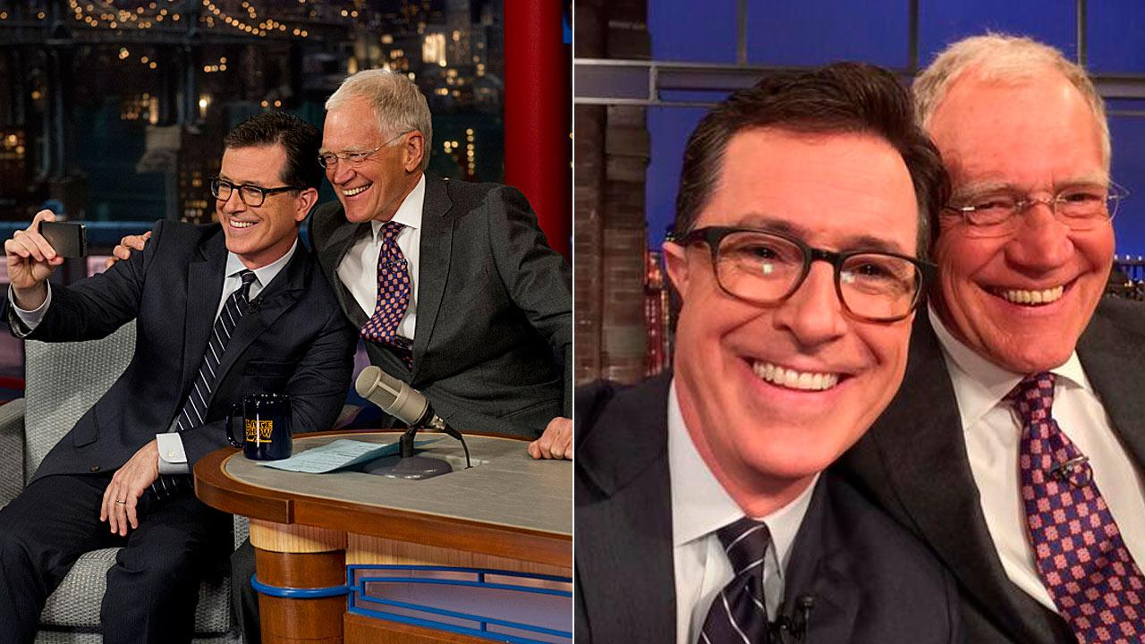 Stephen Colbert appears in a selife with David Letterman while on The Late Show on April 22, 2014.