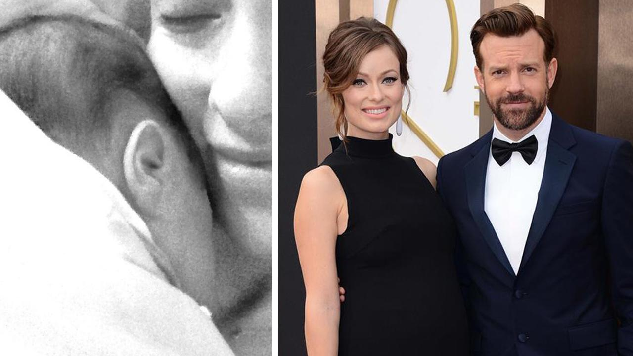 Olivia Wilde shared this photo of her and Jason Sudeikis newborn son, Otis, on her Twitter page on April 23, 2014. / Olivia Wilde and Jason Sudeikis appear at the 2014 Oscars in Hollywood, California on March 2, 2014.