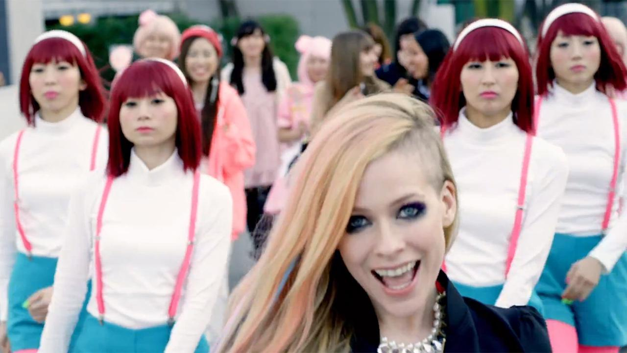 Avril Lavgine appears in her 2014 music video Hello Kitty with background dancers. The singer has denied accusations that the clip is racist.