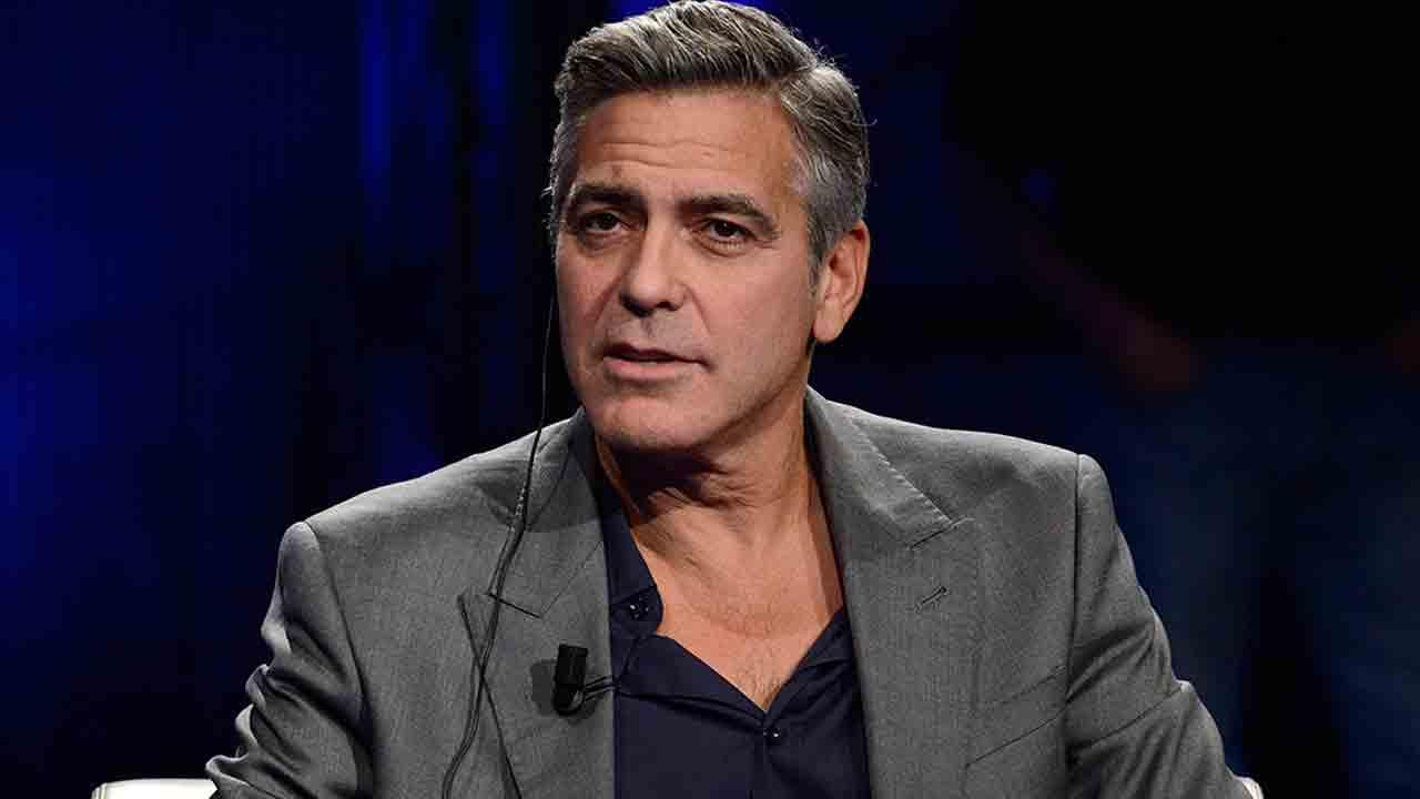 American actor George Clooney is interviewed by Fabio Fazio during the Italian State RAI TV program Che Tempo che Fa, in Milan, Italy, Sunday, Feb. 9, 2014.