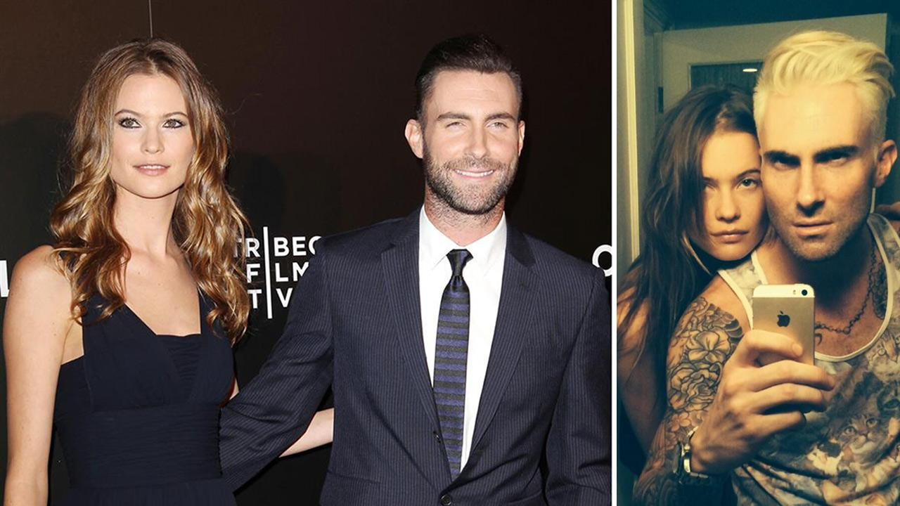 Behati Prinsloo and fiance Adam Levine appear at the premiere of Begin Again at the Tribeca Film Festival in New York on April 26, 2014. / The couple appears in a selfie posted on Levines Twitter page on May 3, 2014.