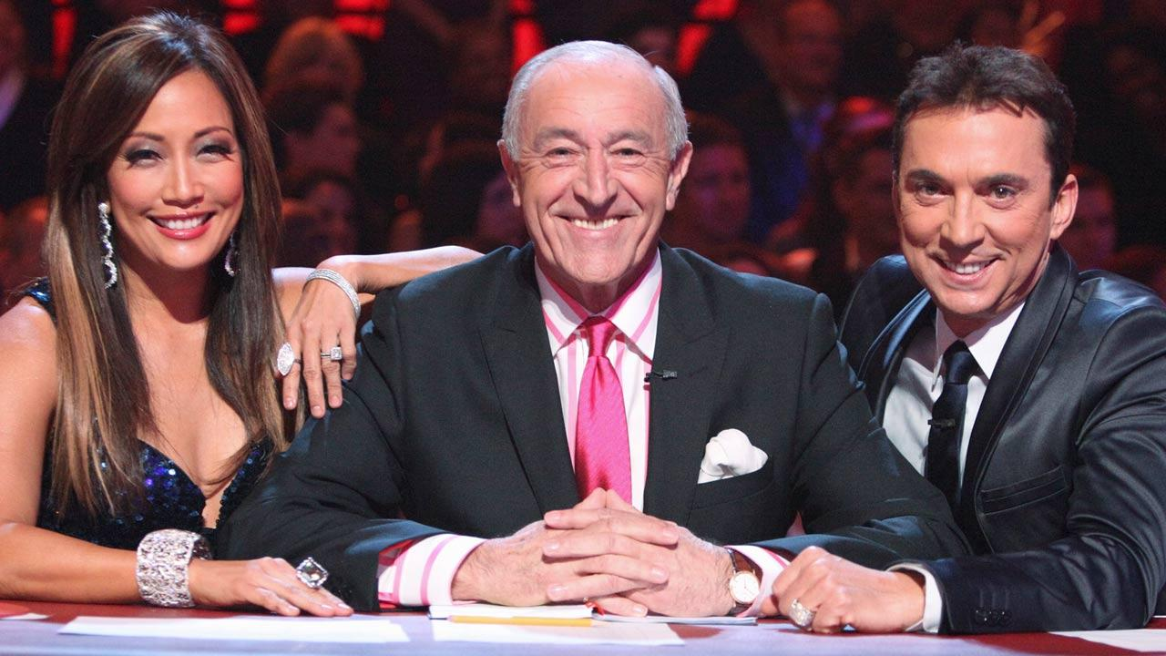 Carrie Ann Inaba, Len Goodman and Bruno Tonioli appear in a promotional photo for Dancing With The Stars season 18 in 2014.